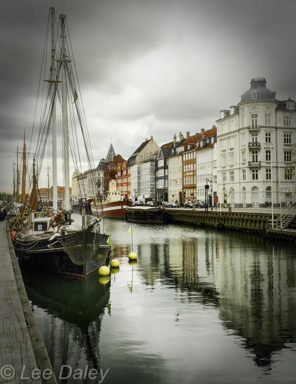 Copenhagen, The Danish GirlVintage wooden boat at Nyhaven harbor front.