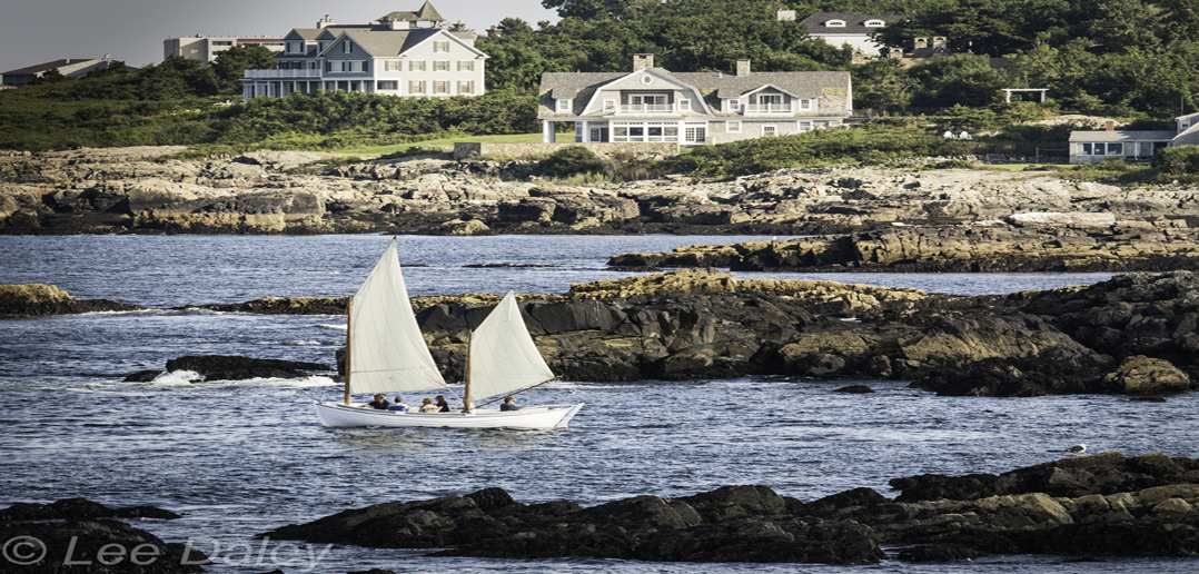 Ogunquit, Maine, beautiful place by the sea, sailboat coming into Perkins Cove, Maine