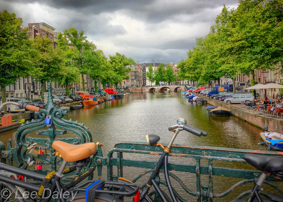Amsterdam: Bikes, bridges and bread. Amsterdam canal with boats and bicycles.