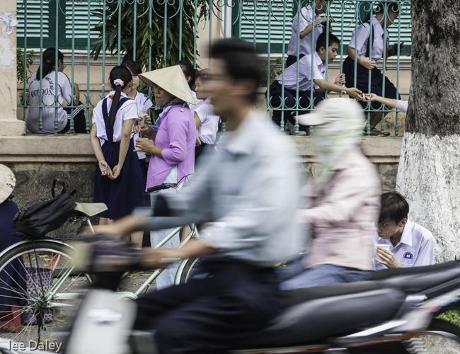 diverse culture of Vietnam, Hanoi Street traffic, moped, cyclos, Hanoi traffic