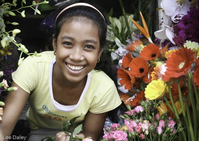 diverse culture of Vietnam, Hanoi flower seller greets with a beautiful smile, Hanoi florist, Vietnam