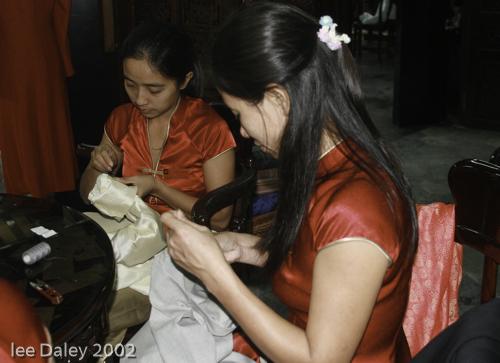 deep culture of Vietnam, Hoi An Seamstresses tailor custom silk clothing, ancient fishing village of Vietnam.