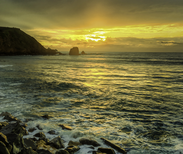 Rockaway Beach, Pacifica,CA, rock outcroppings. rocky shore, sunset reflections on waves, This beach is loved by surfers who catch the long wave action.