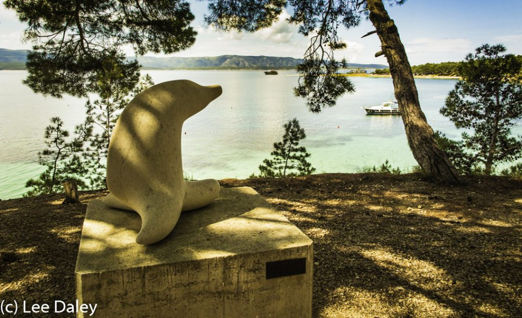 Brac Island. Croatia: Sun, Sea and Stone, Sea Lion looking out to sea, Bol promenade, Bol outdoor sculpture garden