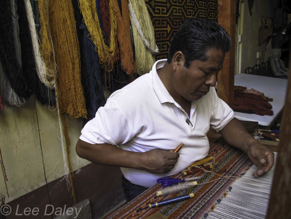Weaver at his loom, Teotitlan, Oaxaca.