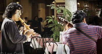 Oaxaca: A collage of culture and cuisine, Oaxaca Cafe Culture, Flute player and guitarist serenade cafe patrons