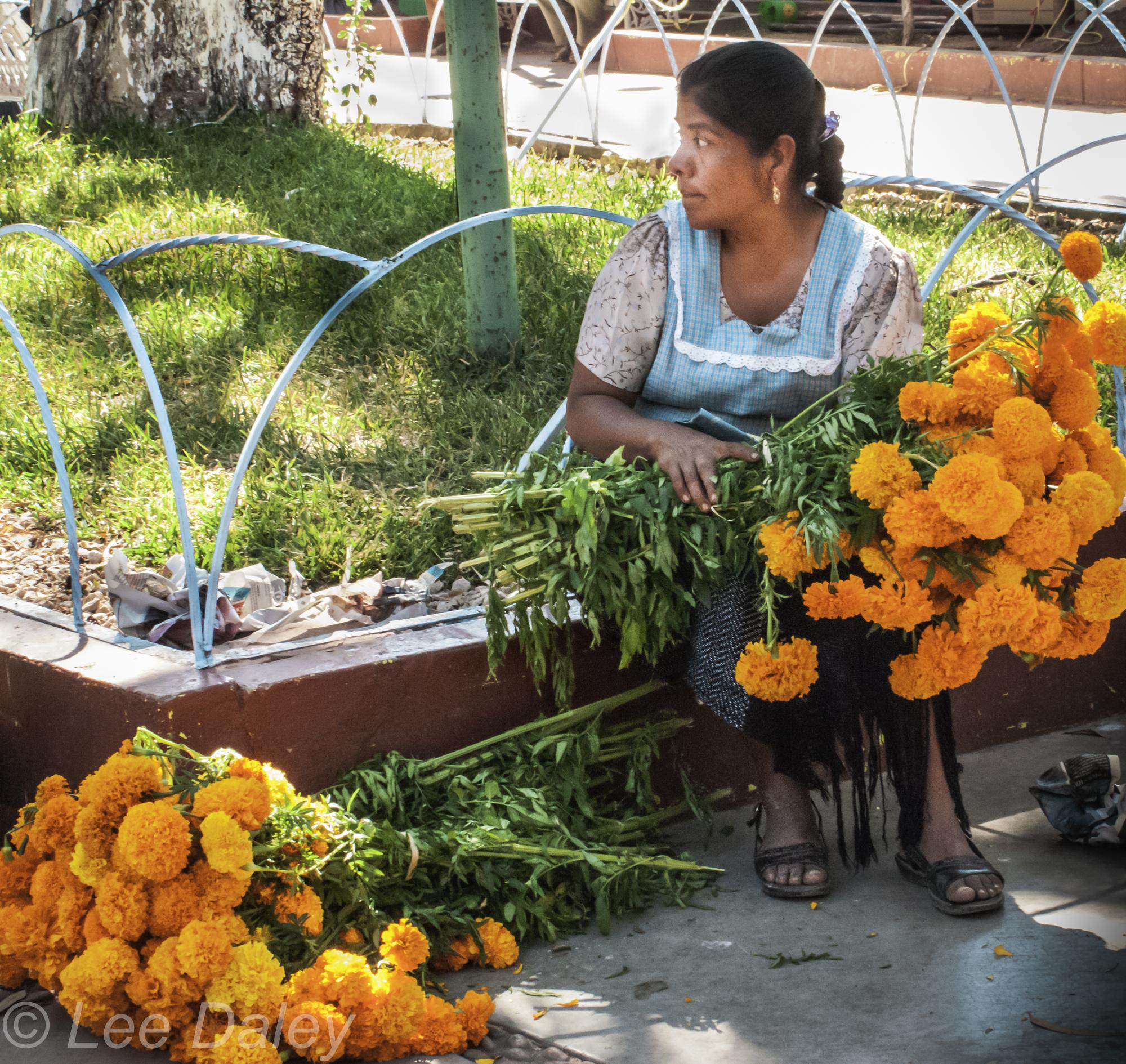 Oaxaca, woman with marigolds