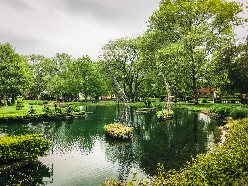 Pond at Topiary Park, Downtown Columbus, Ohio, boats mimic those in the River Seine, in Paris.