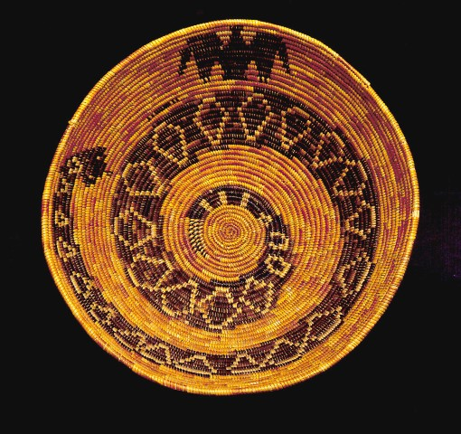 Palm Springs, Rattlesnake Basket with Snake, Photo by Jamison Pollock, courtesy of Palm Springs Art Museum, natural and dyed juncus and sumac on a deer grass foundation.