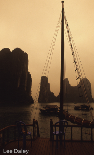 diverse culture of Vietnam, Ha Long Bay, aboard ship on the bay, UNESCO World Heritage site, karsts, sunset on Ha Long Bay