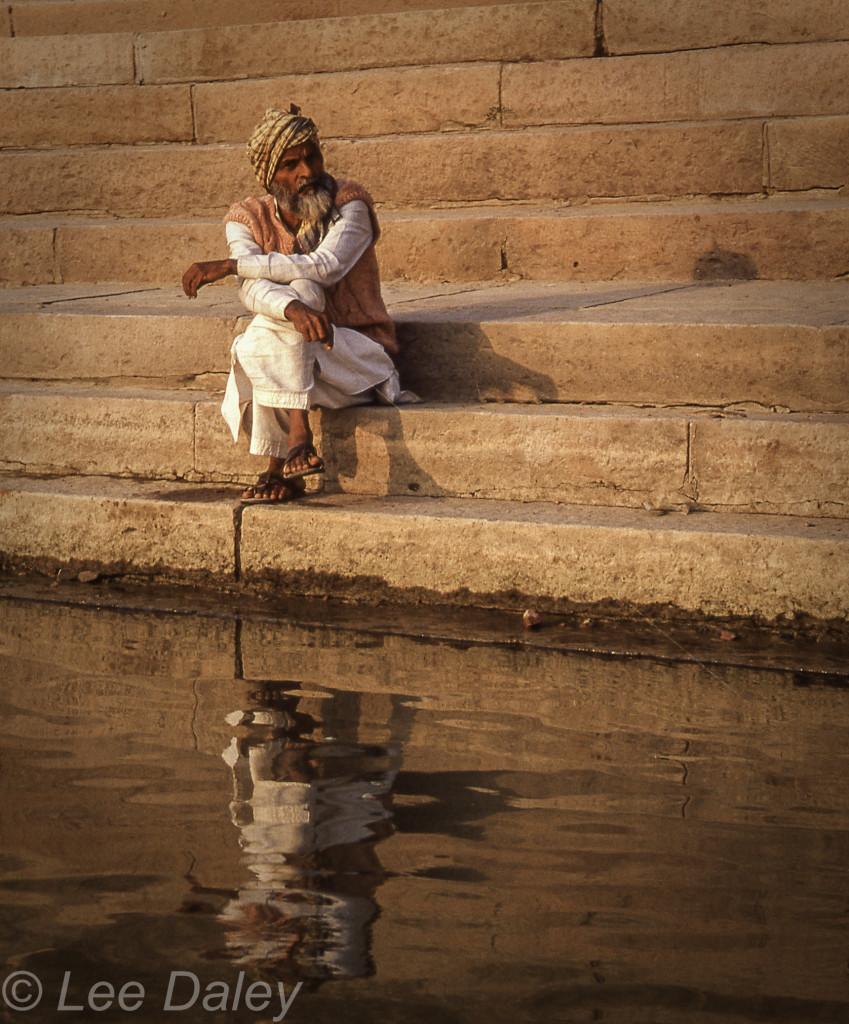 Varanasi: On the Banks of the Ganges, sacred river, Ganges River, Ghats, Assi Ghat, India.Morning on the Ganges
